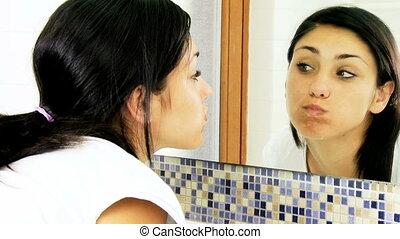 Girl washing teeth thumb up