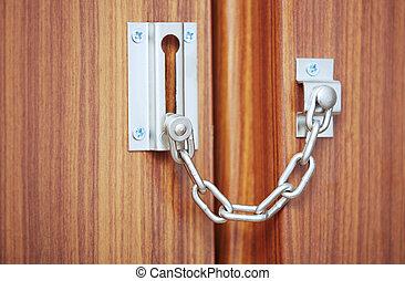 Padlock on the door - Metal padlock on the door. Close-up...
