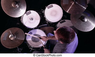 There Go the Drums - High angle of musician playing...