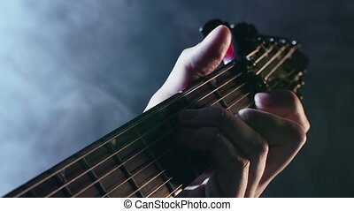 All about Guitar - Extreme close up of male fingers plucking...