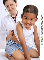 childrens doctor - female doctor examining little child boy