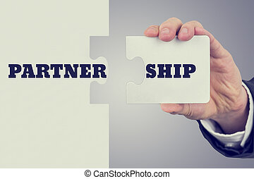 Partnership - Retro image of male hand holding piece of...