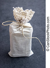 Hand crafted gifts on rustic background,close up