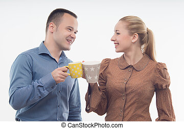 Stylish workmates laughing while having coffee together -...
