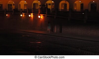 Walking at Night on Medieval Town - Night girl walking on...