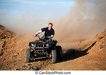 teenager riding quad four wheeler - teenager male riding a...