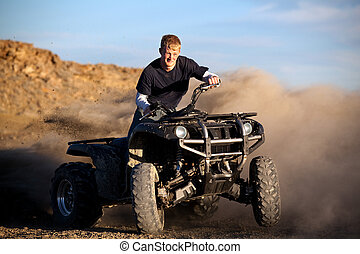 teenager riding quad - male teenager riding a quad 4x4 -...