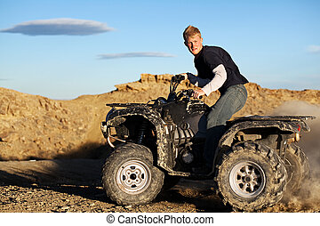 quad - teen driving four wheeler