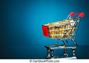 shopping cart full of money on blue background