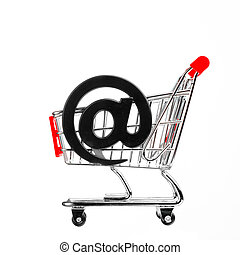 online shopping concept - shopping cart with email symbol