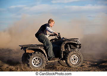 teen riding ATV quad - teenager riding ATV quad - four...