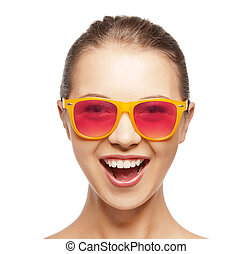 happy teenage girl in shades - happiness and people concept...