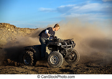 teen on quad four wheeler - Teen male riding quad /...
