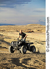 quad in hills - teen on four wheeler - teen riding a quad...