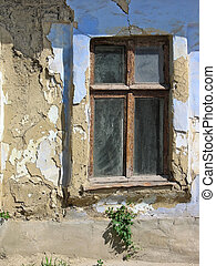 Vintage window, old brown and blue wall, abandoned house