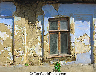 Vintage window, jld brown and blue wall, abandoned house