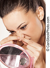 self cosmetician - beautiful young woman squeezing pimples...