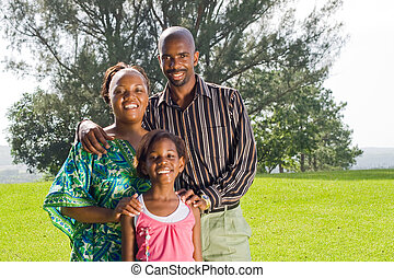 african family in park - african family playing in park