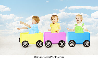 Kids playing toy car. Children passenger sitting in box....