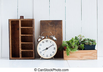 Vintage home decor: old wooden boxes, houseplants, alarm...