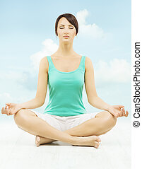 Yoga woman meditate sitting in lotus pose over sky background.