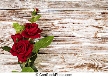 Rose flowers, red on wooden grunge background, floral card...