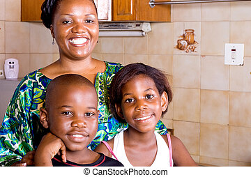 african family - mother, son and daughter spending time...