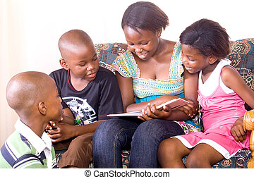 african kids reading - older african sister reading to...