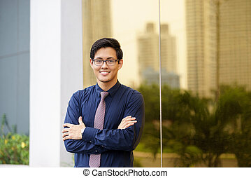 Portrait of proud and confident chinese office worker -...