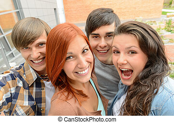 Cheerful student friends taking selfie - Cheerful teenager...