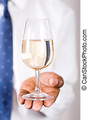 smart man holding wine - man in suit presenting a glass of...