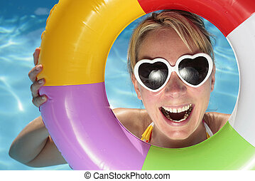 Summer Fun - Laughing woman with sunglasses and inflatable...