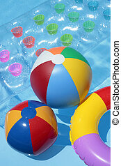 Summer Toy Background - Beach balls, a rubber ring and a...