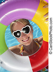 Summertime Fun - Laughing woman with sunglasses and...