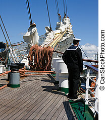 Sailor at old sail ship