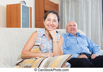 Happy couple grandparents in the house