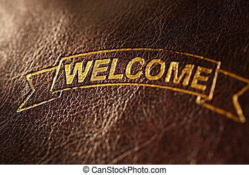 Welcome greeting on leather background