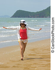 Woman full length with relaxing on the beach