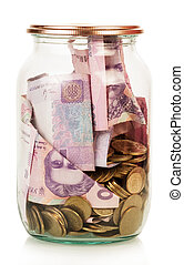 Financial reserves Money conserved in a glass jar isolated...