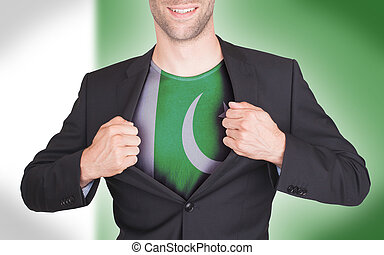 Businessman opening suit to reveal shirt with flag, Pakistan