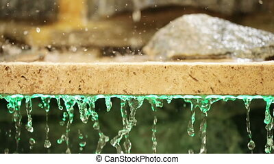Granite slab with stones and waters - Drops of water flowing...