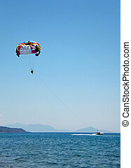Paragliding over the Mediterranian Sea, the blue water...