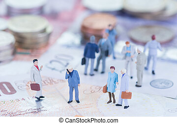 Miniature business people and money - Miniature business...