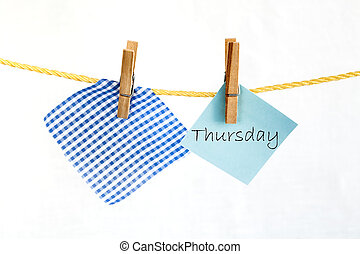 Note colored paper with the word thursday - The paper notes...