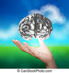 businessman hand showing 3d metal human brain on nature...