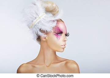 Creativity. Glamorous Fashion Model with Fancy Hair-do with...