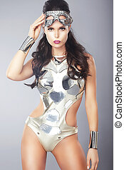 Splendor. Ultramodern Woman with Metallic Mask in Trendy...