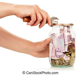 Financial reserves Money conserved in glass jar opened by...