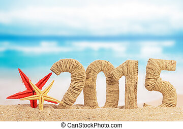 New year 2015 sign on the beach