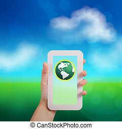 hand holding the phone tablet touch computer gadget with green g